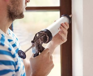 Man Caulking Window Picture