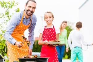 Family Barbecuing Outdoors Picture